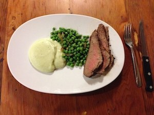 Grass-fed beef with cumin crust, peas and sweet onions, and pureed cauliflower with spring onion